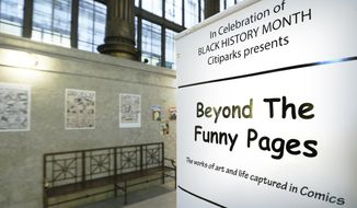 In this Wednesday, Feb. 5, 2014 photo, an exhibit at the City/County building in downtown Pittsburgh is highlighting early artists who helped break the comic book color barrier by featuring black characters and a publisher who started to break the comic color barrier in the 1930s and 1940s. (AP Photo/Keith Srakocic)