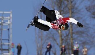 Canada's Mark McMorris takes a jump during the men's  snowboard slopestyle semifinal at the Rosa Khutor Extreme Park, at the 2014 Winter Olympics, Saturday, Feb. 8, 2014, in Krasnaya Polyana, Russia. (AP Photo/Andy Wong)