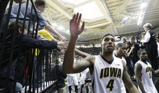 Iowa guard Devyn Marble waves to fans after an NCAA college basketball game against Michigan, Saturday, Feb. 8, 2014, in Iowa City, Iowa. Marble scored 26 points in Iowa's 85-67 win. (AP Photo/Charlie Neibergall)
