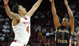Florida State guard Devon Bookert (1) takes a shot over Maryland guard Seth Allen (4) during the first half of an NCAA college basketball game, Saturday, Feb. 8, 2014, in College Park, Md. (AP Photo/Nick Wass)