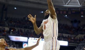 Florida center Patric Young (4) shoots over Alabama forward Nick Jacobs (15) during the first half of an NCAA college basketball game Saturday, Feb. 8, 2014, in Gainesville, Fla. (photo by Phil Sandlin)
