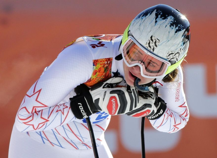 United States' Jacqueline Wiles rests after a women's downhill training run for the Sochi 2014 Winter Olympics, Saturday, Feb. 8, 2014, in Krasnaya Polyana, Russia. (AP Photo/Gero Breloer)