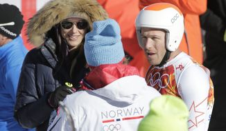 United States' Bode Miller, right, and his wife, Morgan, talk to a Norwegian skier after a men's downhill training run for the Sochi 2014 Winter Olympics, Saturday, Feb. 8, 2014, in Krasnaya Polyana, Russia. (AP Photo/Gero Breloer)