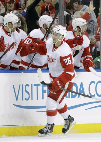 Detroit Red Wings right wing Tomas Jurco (26) celebrates with the bench aftar scoring against the Tampa Bay Lightning during the second period of an NHL hockey game, Saturday, Feb. 8, 2014, in Tampa, Fla. (AP Photo/Chris O'Meara)