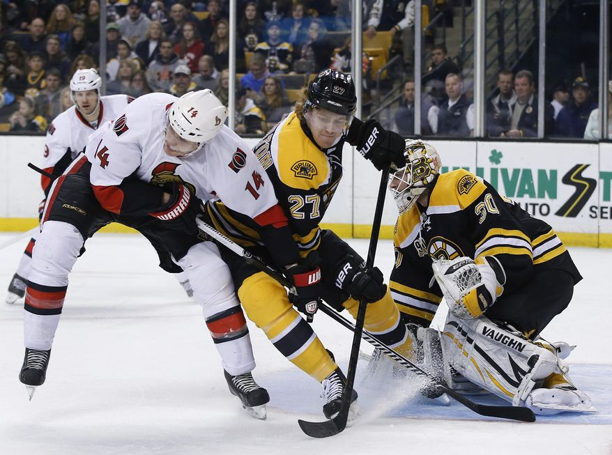 Boston Bruins defenseman Dougie Hamilton (27) keeps Ottawa Senators left wing Colin Greening (14) from getting position as Boston Bruins goalie Chad Johnson (30) protects the net during the first period of an NHL hockey game in Boston, Saturday, Feb. 8, 2014. (AP Photo/Elise Amendola)