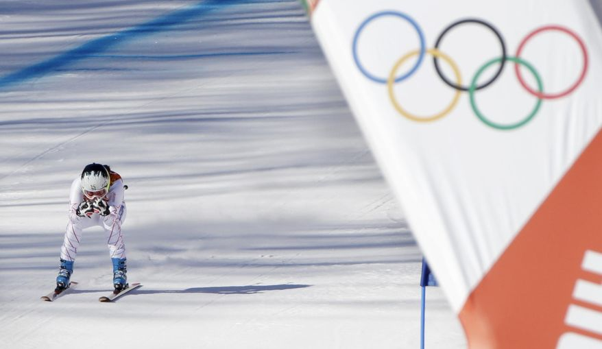 United States' Jacqueline Wiles approaches the finish in a women's downhill training run for the Sochi 2014 Winter Olympics, Saturday, Feb. 8, 2014, in Krasnaya Polyana, Russia. (AP Photo/Gero Breloer)