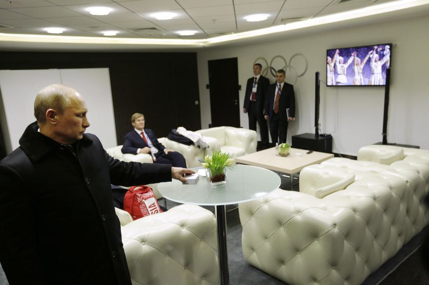 In this third in a sequence of four images, two seconds after the previous one, Russian President Vladimir Putin turns toward a TV screen in the presidential lounge while waiting to be introduced at the opening ceremony of the 2014 Winter Olympics on Friday, Feb. 7, 2014, in Sochi, Russia. Early in the ceremony, the image on the TV cut to performers after one of the five Olympic rings failed to open. (AP Photo/David Goldman, Pool)