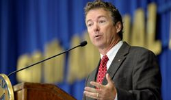 """Attacks by Sen. Rand Paul, Kentucky Republican, on former President Bill Clinton as a """"sexual predator"""" are seen by many as an indirect strike on Hillary Rodham Clinton's prospective 2016 presidential candidacy. (Associated Press photographs)"""