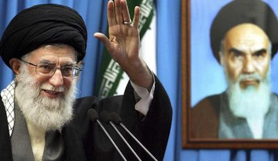 ** FILE ** In this Friday, Feb. 3, 2012, file photo released by an official website of the Iranian supreme leader's office, Iranian supreme leader Ayatollah Ali Khamenei waves to the worshippers, in front of a portrait of the late revolutionary founder Ayatollah Khomeini, before he delivers his Friday prayers sermon, at the Tehran University campus, Iran. (AP Photo/Office of the Supreme Leader, File)