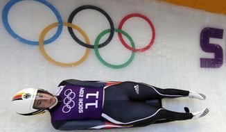 Natalie Geisenberger of Germany slides down the track during a training session for the women's singles luge at the 2014 Winter Olympics, Saturday, Feb. 8, 2014, in Krasnaya Polyana, Russia. (AP Photo/Michael Sohn)