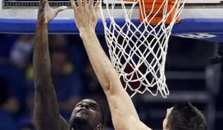 Indiana Pacers' Lance Stephenson, left, makes a shot over Orlando Magic's Nikola Vucevic, right, of Montenegro, during the first half of an NBA basketball game in Orlando, Fla., Sunday, Feb. 9, 2014. (AP Photo/John Raoux)
