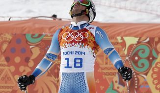 Norway's Aksel Lund Svindal reacts after finishing the men's downhill at the Sochi 2014 Winter Olympics, Sunday, Feb. 9, 2014, in Krasnaya Polyana, Russia. (AP Photo/Christophe Ena)