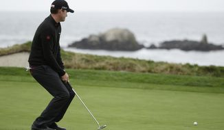 Jimmy Walker reacts after missing a birdie putt on the fourth green during the final round of the AT&T Pebble Beach Pro-Am golf tournament, Sunday, Feb. 9, 2014, in Pebble Beach, Calif. (AP Photo/Eric Risberg)