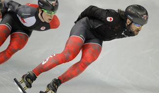 Charles Hamelin of Canada, right, trains during a short track speedskating practice session at the Iceberg Skating Palace ahead of the 2014 Winter Olympics, Thursday, Feb. 6, 2014, in Sochi, Russia. (AP Photo/Vadim Ghirda)