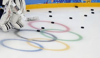 Molly Schaus, goalkeeper of the U.S. women's ice hockey team, attends a practice session ahead of the 2014 Winter Olympics, Thursday, Feb. 6, 2014, in Sochi, Russia. (AP Photo/Petr David Josek)