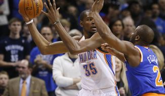 Oklahoma City Thunder forward Kevin Durant (35) is pressured by New York Knicks guard Raymond Felton (2) in the first quarter of an NBA basketball game in Oklahoma City, Sunday, Feb. 9, 2014. (AP Photo/Sue Ogrocki)