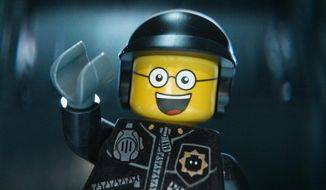 "This image released by Warner Bros. Pictures shows the character Bad Cop/Good Cop, voiced by Liam Neeson, in a scene from ""The Lego Movie."" (AP Photo/Warner Bros. Pictures, file)"