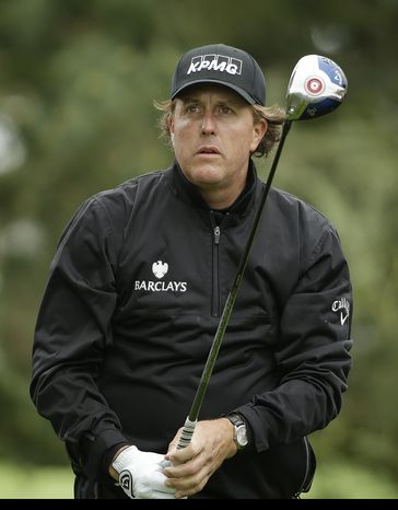 Phil Mickelson follows the ball after hitting off the second tee on Sunday, Feb. 9, 2014, during the final round of the AT&T Pebble Beach Pro-Am golf tournament in Pebble Beach, Calif. (AP Photo/Ben Margot)