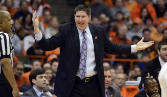 Clemson head coach Brad Brownwell lodges a complaint during the first half against Syracuse in an NCAA college basketball game in Syracuse, N.Y., Sunday, Feb. 9, 2014. (AP Photo/Kevin Rivoli)