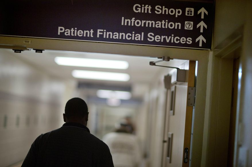 ** FILE ** In this Friday, Jan. 24, 2014, photo, a sign points visitors toward the financial services department at Grady Memorial Hospital, in Atlanta. (AP Photo/David Goldman)