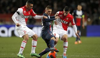 Paris Saint Germain's Marco Verratti of Italy, center, challenges for the ball with Monaco's Emmanuel Riviere of France, left, and Monaco's James Rodriguez of Colombia during their French League One soccer match, in Monaco stadium, Sunday, Feb. 9 , 2014. (AP Photo/Lionel Cironneau)