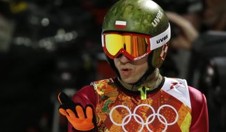 Poland's Kamil Stoch blows a kiss after his first attempt during the men's normal hill ski jumping final at the 2014 Winter Olympics, Sunday, Feb. 9, 2014, in Krasnaya Polyana, Russia. (AP Photo/Gregorio Borgia)
