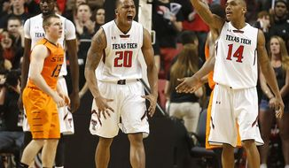 Texas Tech's Toddrick Gotcher(20) and Robert Turner(14) celebrate after scoring against Oklahoma State during their NCAA college basketball game in Lubbock, Texas, Saturday, Feb, 8, 2014.  (AP Photo/Lubbock Avalanche-Journal, Tori Eichberger) ALL LOCAL TV OUT