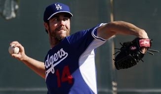 Los Angeles Dodgers' Dan Haren pitches during spring training baseball practice Sunday, Feb. 9, 2014, in Glendale, Ariz. (AP Photo/Paul Sancya)