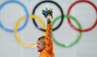 Gold medallist Michel Mulder of the Netherlands celebrates during the flower ceremony for the men's 500-meter speedskating race at the Adler Arena Skating Center at the 2014 Winter Olympics, Monday, Feb. 10, 2014, in Sochi, Russia. (AP Photo/Patrick Semansky)