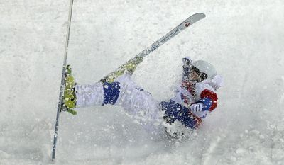 Russia's Sergei Volkov crashes during the men's moguls qualifying at the Rosa Khutor Extreme Park at the 2014 Winter Olympics, Monday, Feb. 10, 2014, in Krasnaya Polyana, Russia. (AP Photo/Andy Wong)