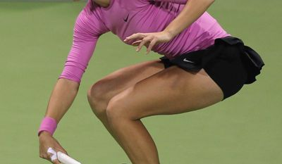 Croatia's Petra Martic returns the ball during a match against Venus Williams of U.S  during the first day of the WTA Qatar Ladies Open in Doha, Qatar, Monday, Feb. 10, 2014. (AP Photo/Osama Faisal)