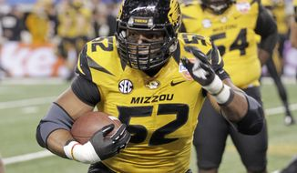 FILE - In this Jan. 3, 2014 file photo, Missouri defensive lineman Michael Sam (52) warms up before the Cotton Bowl NCAA college football game against Oklahoma State, in Arlington, Texas. Michael Sam hopes his ability is all that matters, not his sexual orientation.  Missouri's All-America defensive end came out to the entire country Sunday night, Feb. 9, 2014, and could become the first openly gay player in America's most popular sport. (AP Photo/Tim Sharp, File)