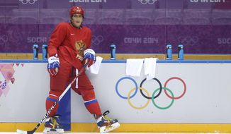 Russia forward Alexander Ovechkin waits to rotate into a drill during a training session at the 2014 Winter Olympics, Monday, Feb. 10, 2014, in Sochi, Russia. (AP Photo/Julie Jacobson)