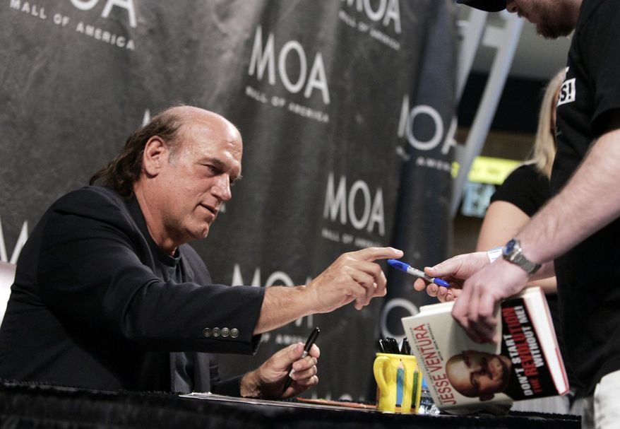 """FILE - In this May 15, 2008 file photo, former Minnesota Gov. Jesse Ventura signs his new book, """"Don't Start the Revolution Without Me,"""" during an appearance at the Mall of America in Bloomington, Minn. Ventura contends he isn't going after the widow of slain """"American Sniper"""" author Chris Kyle by continuing his defamation lawsuit. Ventura told The Associated Press late Monday, Feb. 10, 2014, his fight is with the publisher's insurance company.  (AP Photo/Jim Mone, File)"""