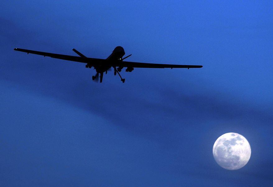 FILE - In this Jan. 31, 2010 file photo an unmanned U.S. Predator drone flies over Kandahar Air Field, southern Afghanistan, on a moon-lit night. An American citizen who is a member of al-Qaida is actively planning attacks against Americans overseas, U.S. officials say, and the Obama administration is wrestling with whether to kill him with a drone strike and how to do so legally under its new stricter targeting policy issued last year. The CIA drones watching him cannot strike because he's a U.S. citizen and the Justice Department must build a case against him, a task it hasn't completed. And President Barack Obama's new policy says American suspected terrorists overseas can only be killed by the military, not the CIA, creating a policy conundrum for the White House.  (AP Photo/Kirsty Wigglesworth, File)