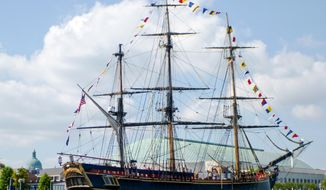 FILE - In this June 17, 2012, file photo, a replica of the historic ship HMS Bounty, is moored beside the U.S. Naval Academy in Annapolis, M.D. The National Transportation Safety Board says the former captain of a replica 18th-century sailing ship that sank off North Carolina during Hurricane Sandy made a reckless decision to sail into the storm. (AP Photo/Blake Sell, File)