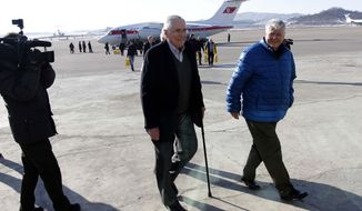 Pacific Century Institute Chairman Donald Gregg, center, and his party arrive at Pyongyang Airport in Pyongyang, North Korea, Monday, Feb. 10, 2014. Gregg, a former U.S. ambassador to South Korea, arrived in Pyongyang on Monday with representatives of the Pacific Century Institute, a private U.S. group. Gregg wouldn't say what he hoped to discuss there. (AP Photo/Jon Chol Jin)