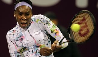 Venus Williams of U.S returns the ball during a match against Croatia's Petra Martic on the first day of the WTA Qatar Ladies Open in Doha, Qatar, Monday, Feb. 10, 2014. (AP Photo/Osama Faisal)