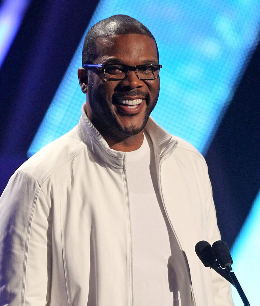 """FILE - In this Sunday, July 1, 2012, file photo, Tyler Perry smiles on stage at the BET Awards, in Los Angeles. Essence is known for honoring black women, but during Oscar week, they'll also be lauding the accomplishments of African-American men in film. The magazine is launching its first """"Black Men in Hollywood"""" dinner, an intimate affair that will salute the work of Spike Lee, Lee Daniels, Malcolm Lee and filmmaker Perry, who will host the event. (Photo by Matt Sayles/Invision/AP, File)"""