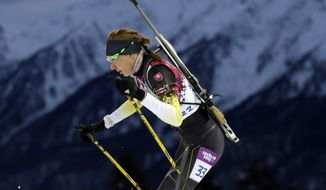 Slovakia's Anastasiya Kuzmina competes to win the gold medal in the women's biathlon 7.5k sprint, at the 2014 Winter Olympics, Sunday, Feb. 9, 2014, in Krasnaya Polyana, Russia. (AP Photo/Felipe Dana)