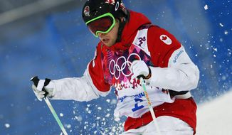 Canada's Alex Bilodeau runs the course during the men's moguls qualifying at the Rosa Khutor Extreme Park at the 2014 Winter Olympics, Monday, Feb. 10, 2014, in Krasnaya Polyana, Russia.  (AP Photo/Sergei Grits)