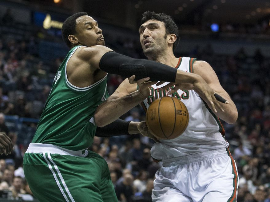 Boston Celtics' Jared Sullinger, left, strips the ball from Milwaukee Bucks' Zaza Pachulia during the second half of an NBA basketball game, Monday, Feb. 10, 2014, in Milwaukee. (AP Photo/Tom Lynn)