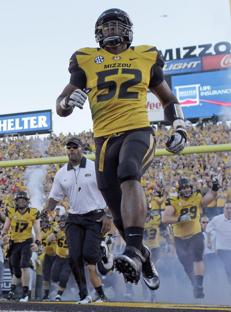 FILE - In this Sept. 8, 2012 file photo, Missouri's Michael Sam (52) runs onto the field along with their teammates before the start of an NCAA college football game against Georgia in Columbia, Mo. Michael Sam hopes his ability is all that matters, not his sexual orientation.  Missouri's All-America defensive end came out to the entire country Sunday night, Feb. 9, 2014, and could become the first openly gay player in America's most popular sport. (AP Photo/Jeff Roberson, File)