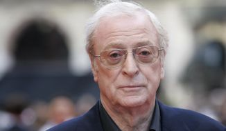 In this July 21, 2008, file photo, British actor Michael Caine arrives for the European Premiere of 'The Dark Knight', in central London. (AP Photo/Joel Ryan, File)