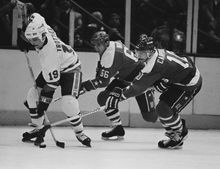 New York Islanders center Bryan Trottier, left, directs the puck against pursuing Washington Capitals in Uniondale, New York, April 7, 1983. Hot on Trottier's heels are Caps Milan Novy, center, and Bob Carpenter in the third period at Nassau Coliseum. Isles beat the Caps 5-2 with Trottier scoring two for the Isles. (AP Photo/Richard Drew)