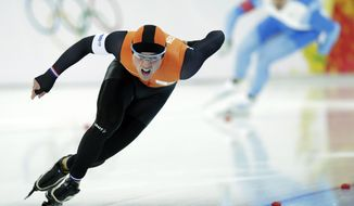 Jan Smeekens of the Netherlands, front and Mika Poutala of Finland compete in the first heat of the men's 500-meter speedskating race at the Adler Arena Skating Center during the 2014 Winter Olympics, Monday, Feb. 10, 2014, in Sochi, Russia. (AP Photo/Matt Dunham)