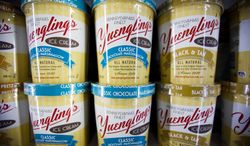 Shown are cartons of Yuengling ice-cream at a Weis supermarket, Monday, Feb. 10, 2014, in Huntingdon Valley, Pa. Yuengling's Ice Cream is back after an absence of nearly 30 years, available at hundreds of stores in Pennsylvania, Virginia, Maryland, West Virginia, Delaware and New Jersey.  (AP Photo/Matt Rourke)