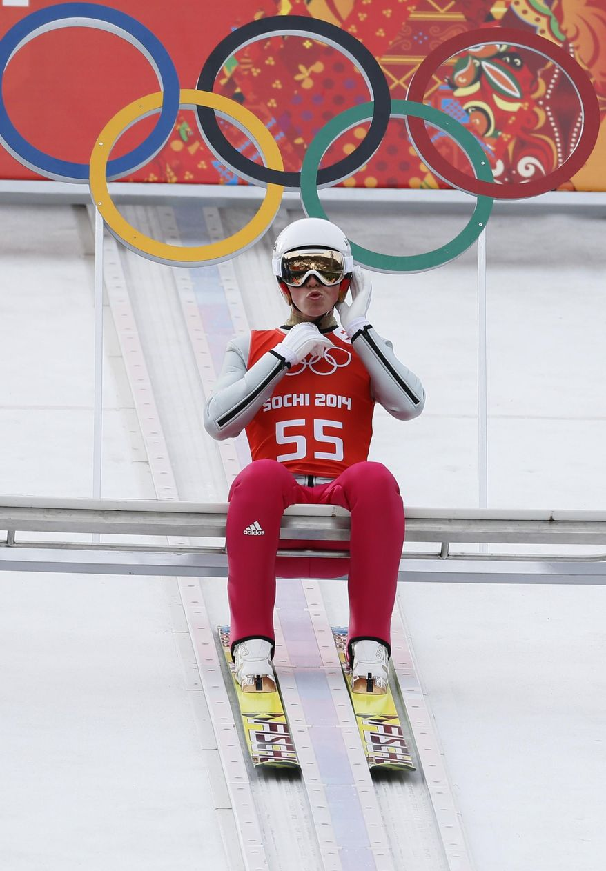 Germany's Eric Frenzel prepares to make an attempt during a men's nordic Combined training session at the 2014 Winter Olympics, Sunday, Feb. 9, 2014, in Krasnaya Polyana, Russia. (AP Photo/Dmitry Lovetsky)