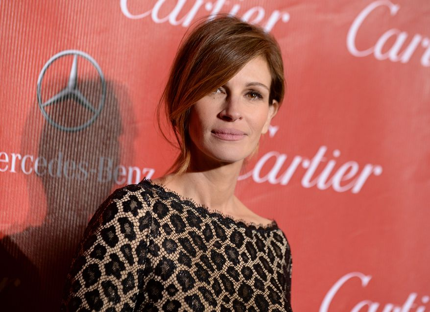 ** FILE ** In this Jan. 4, 2014, file photo, Julia Roberts arrives at the Palm Springs International Film Festival Awards Gala at the Palm Springs Convention Center in Palm Springs, Calif. The Los Angeles coroner's office is investigating the death of Nancy Motes, 37, the half-sister of actors Julia and Eric Roberts. Motes was found dead in a Los Angeles home on Sunday, Feb. 9, 2014. (Photo by Jordan Strauss/Invision/AP, File)