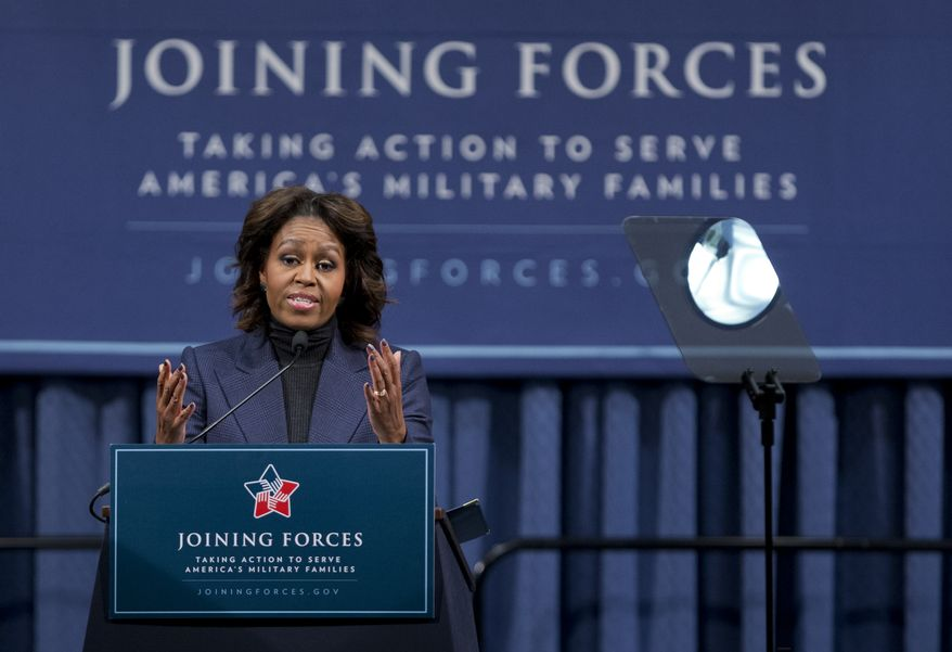 First lady Michelle Obama speaks at a National Symposium on Veterans' Employment in Construction, hosted by the Labor Department, Monday, Feb. 10, 2014, in Washington. Mrs. Obama said a construction industry pledge to hire 100,000 veterans by 2019 isn't only the right and patriotic thing to do, but also a smart thing for business.   (AP Photo/Manuel Balce Ceneta)